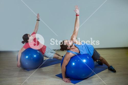 Men exercising with exercise ball