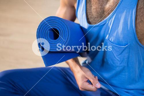 Man holding exercise mat