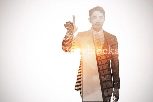 Stern asian businessman pointing