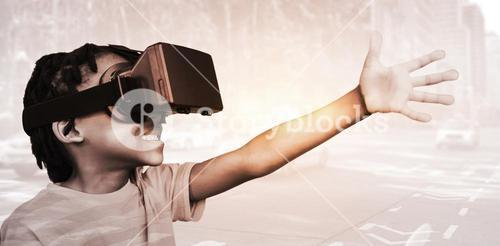 Composite image of side view of little boy holding virtual glasses on a white background