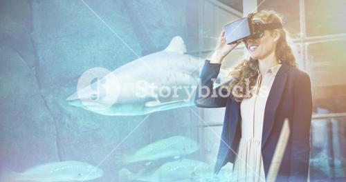 Composite image of shark swimming in fish tank