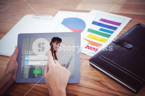 Composite image of over shoulder view of hipster woman using tablet