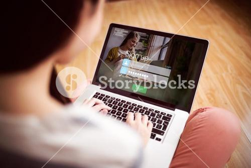 Composite image of signup screen with blonde girl and pad
