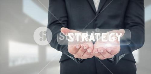 Composite image of businessman holding his hands out