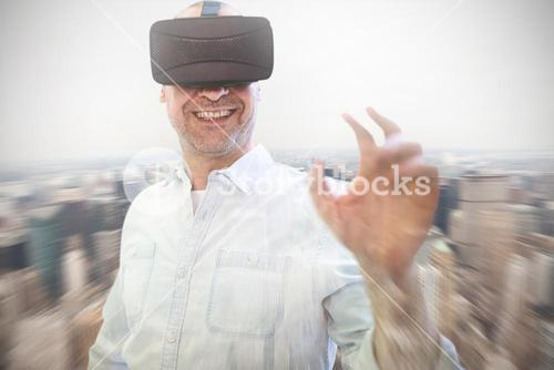 Composite image of man using an oculus