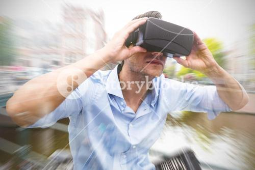 Composite image of man using a virtual reality device