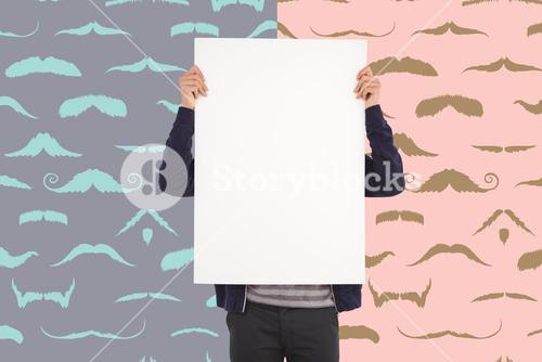 Composite image of man showing billboard in front of face