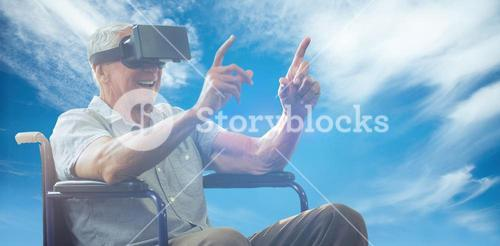 Composite image of senior man holding virtual glasses sitting on his wheelchair