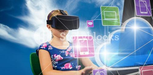 Composite image of little girl holding virtual glasses front of her computer