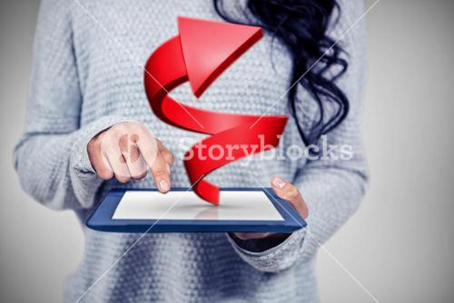 Composite image of mid section of asian woman using tablet