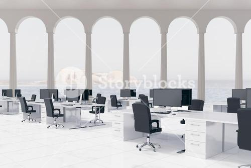 Empty office with desks and computers