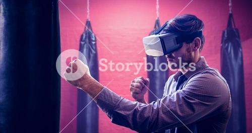 Composite image of man using an oculus and fighting