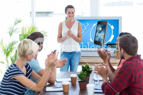 Composite image of colleagues clapping hands in a meeting