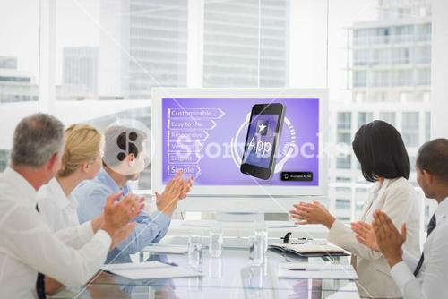 Composite image of business team clapping during a conference