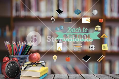School materials and apple with back to school text and library background