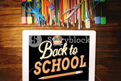 School materials with tablet computer with back to school text