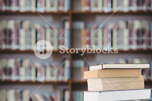 stack of books with library background