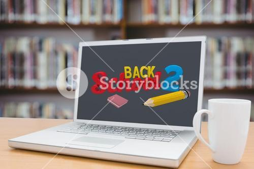 laptop with back to school text and coffee mug with library background