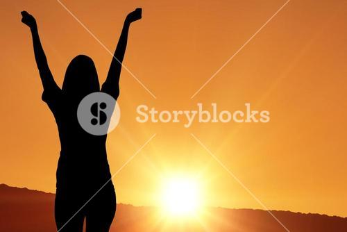 cheering silhouette on sunset background