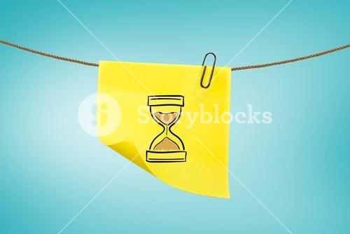 hourglass on post-it with blue background