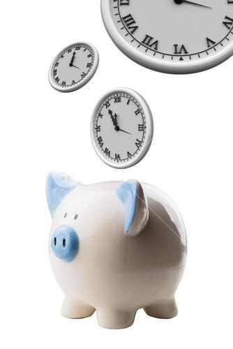 piggy bank and clocks