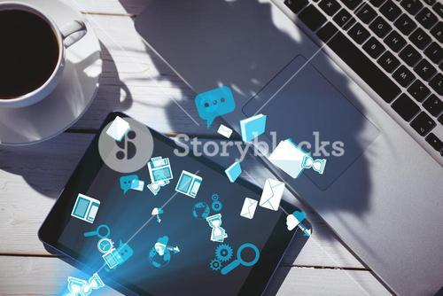 smart devices with coffee on table with graphics