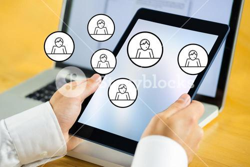 hands using tablet computer with people graphics