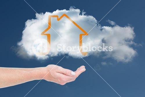 Hand carrying house in a cloud
