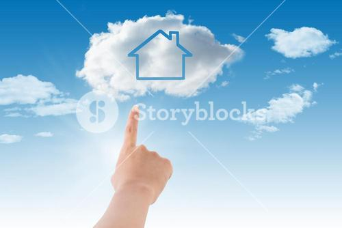Hand pointing a cloud with house inside