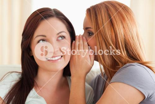 Gorgeous woman being told a secret