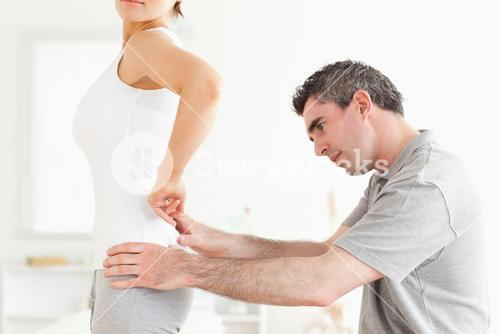 CHiropractor examining a womans back