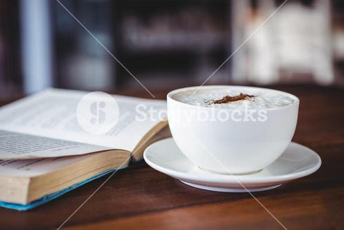 Coffee cup and book on a table