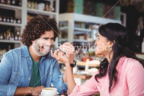 Happy couple eating dessert