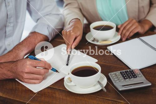 Man and woman meeting over coffee