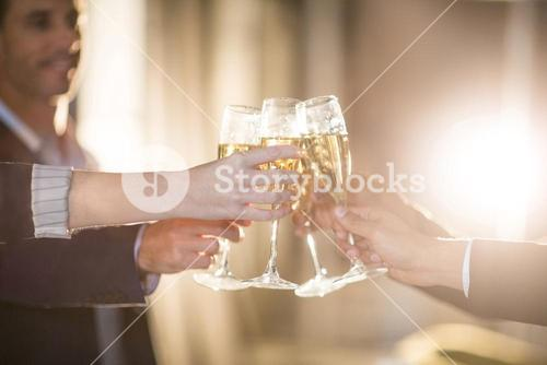 Group of businesspeople toasting glasses of champagne