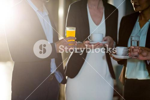 Businesspeople interacting during a break in the office