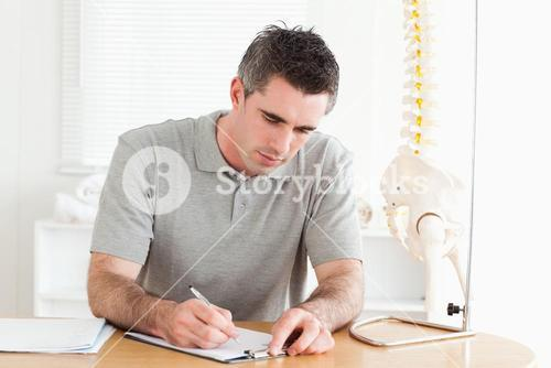 Male Doctor sitting at a table working