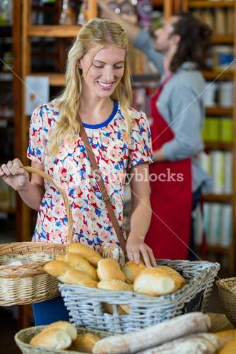 Smiling woman purchasing bread