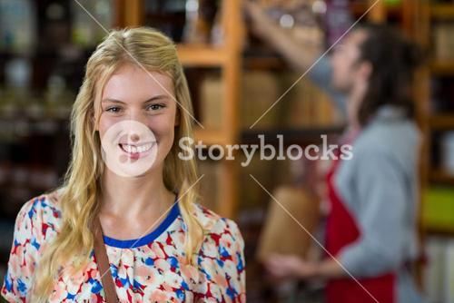 Smiling woman in supermarket