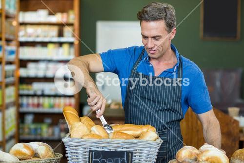Male staff working at bakery store