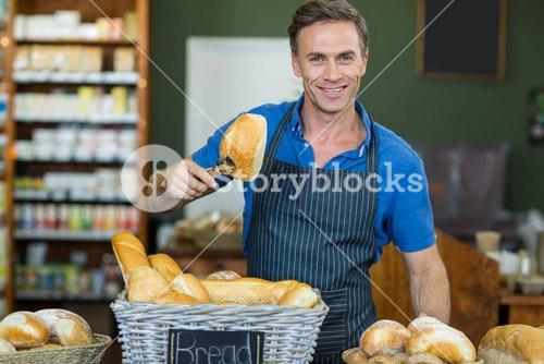 Portrait of male staff working at bakery store
