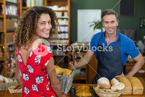 Smiling woman standing at bakery counter