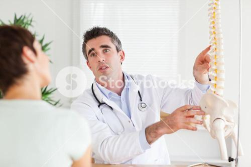 Male Doctor explaining something to a woman