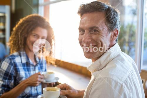 Couple having a cup of tea in supermarket