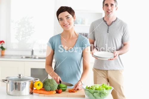 Smiling Couple preparing lunch