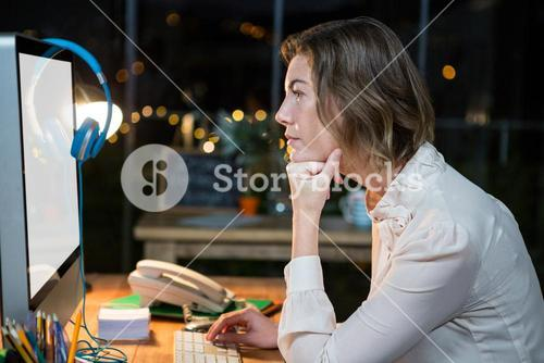 Businesswoman working on computer at her desk
