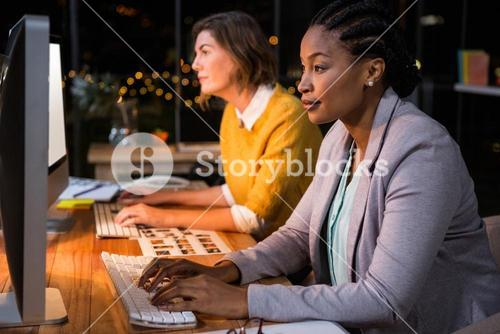 Businesswomen working on computer at their desk
