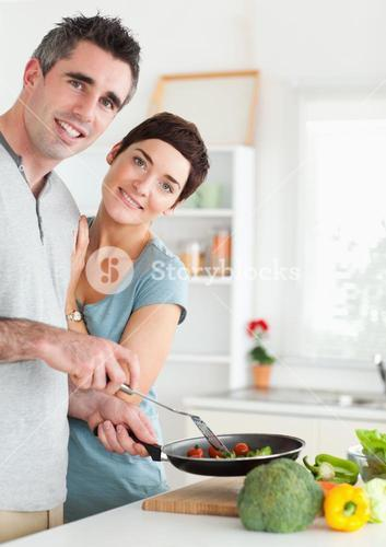 Gorgeous Woman and her panholding husband looking into the camera