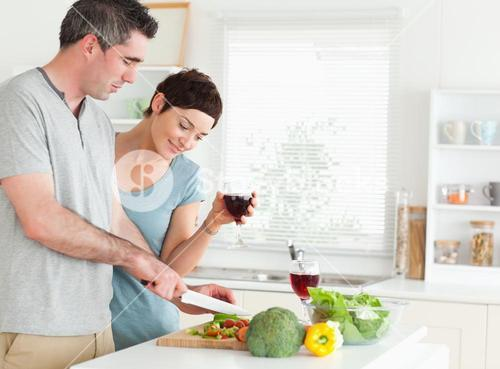 Couple with wine and vegetables