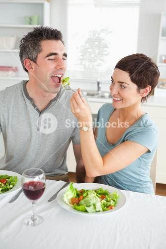 Woman feeding her boyfriend